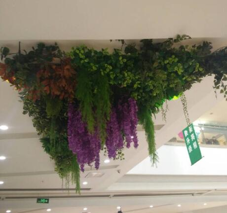 Shopping malls apply artificial vertical garden upside down to the ceiling!